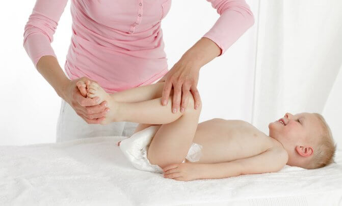 A craniosacral fascial therapy provider works with a 3-year-old child