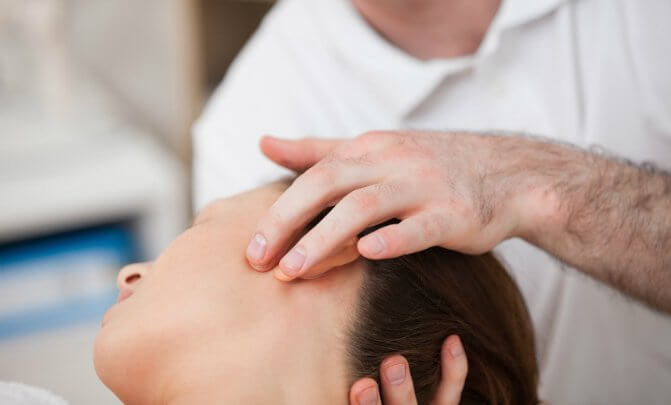Woman with torticollis receives craniosacral fascial therapy