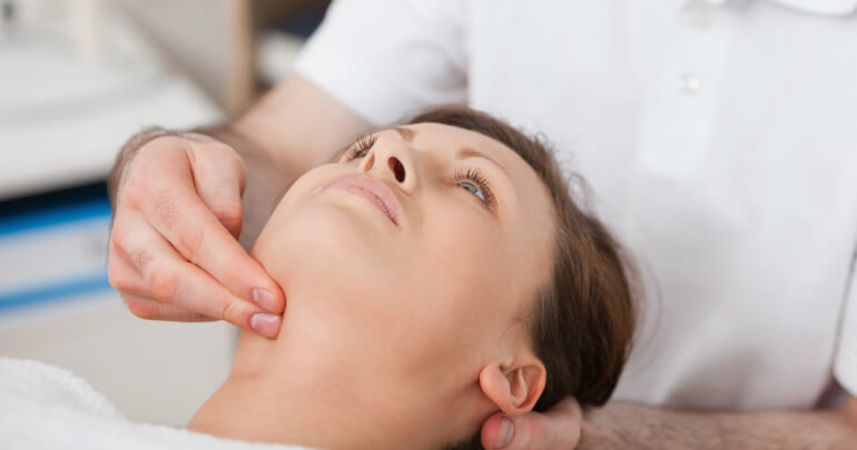 Arching patient receives Gillespie Approach–Craniosacral Fascial Therapy