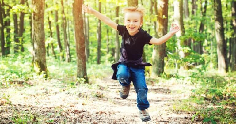 Happy boy runs outside - Gillespie Approach–Craniosacral Fascial Therapy